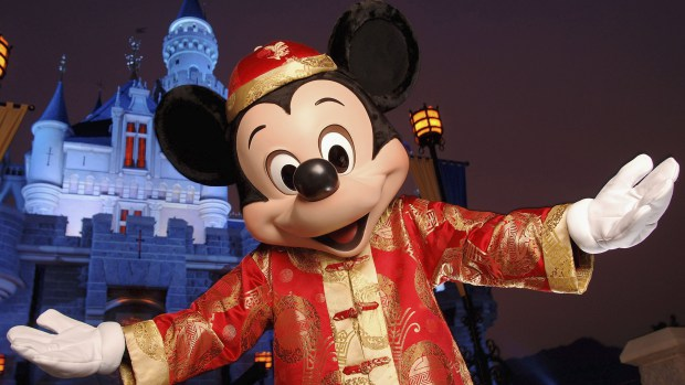 HONG KONG - SEPTEMBER 1: (EDITORIAL USE ONLY)  In this handout photo provided by Disney, Mickey Mouse is seen in front of the Sleeping Beauty Castle at the new Disneyland Park on September 1, 2005 in Hong Kong.  The new theme park and vacation resort will officially open September 12. (Photo by Mark Ashman/Disney via Getty Images)